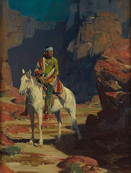 Indian on horseback in a canyon